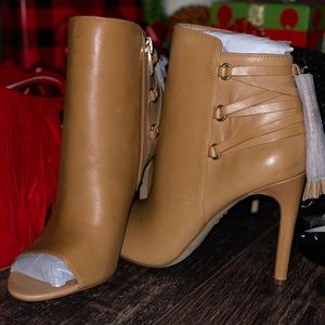 Beautiful peep toe booties with gorgeous accents